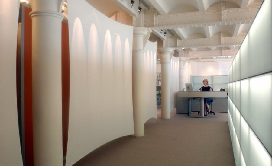 Acoustic fabric screens in an office space