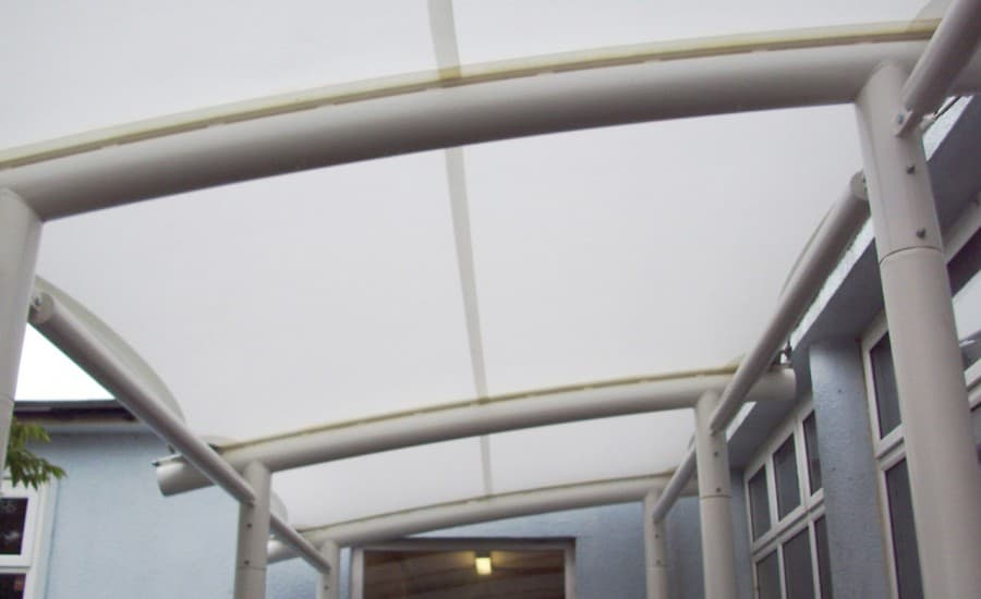 Fabric canopies covering outdoor space at a school