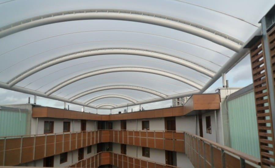 ETFE fabric roof over atrium space in apartment building