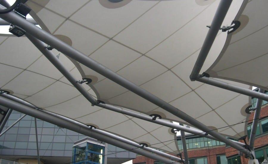 Arrow shaped fabric canopies