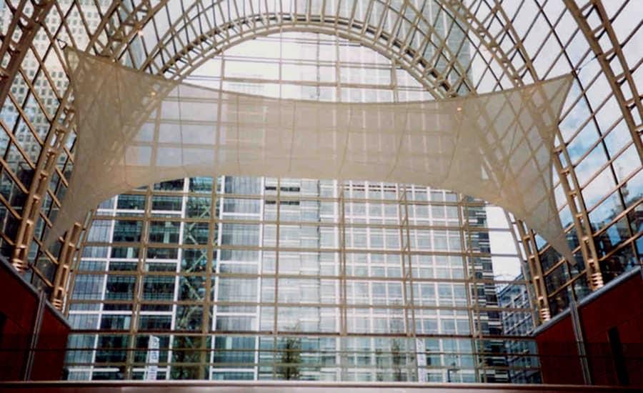Tensile fabric feature in glass atrium