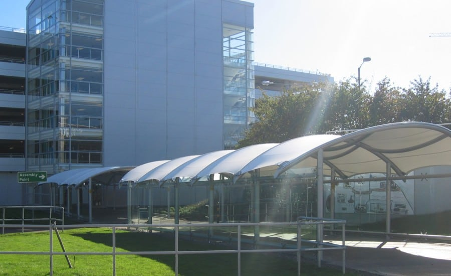 Curved tensile fabric walkway