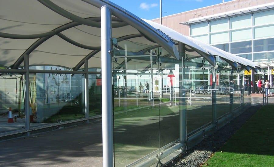 Tensile fabric shletered walkway