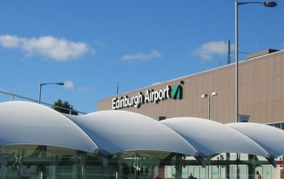 White fabric canopy protecting airport walkway