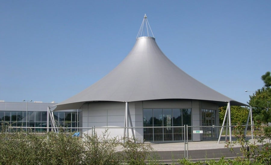 Fabric structure over a building