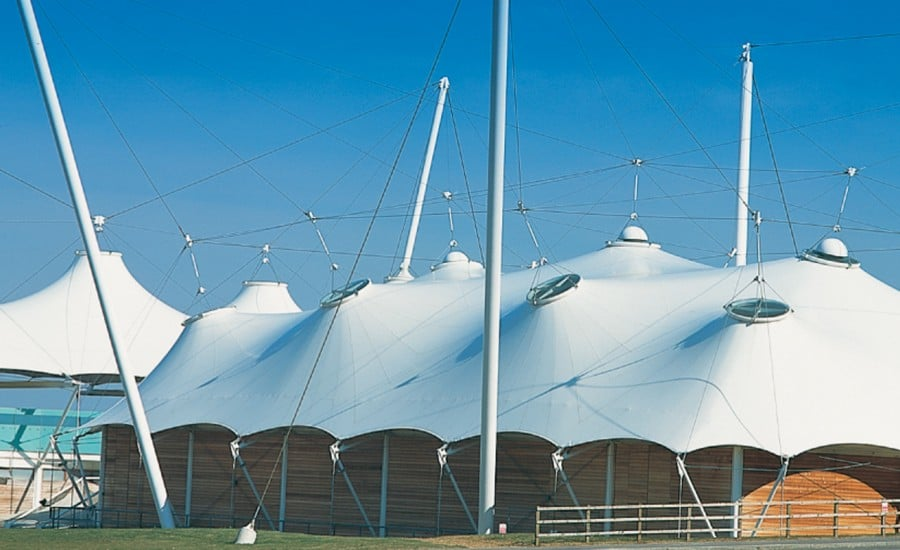 White tensile canopies covering buildings