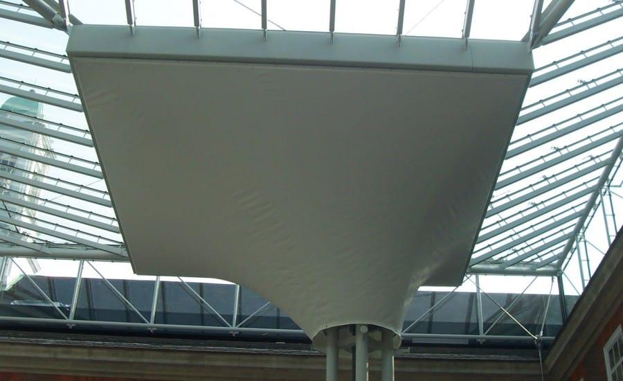 Tensile fabric interior conic structure