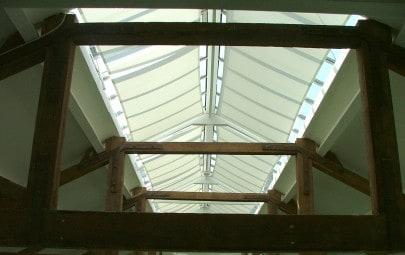 Fabric screens providing solar shading