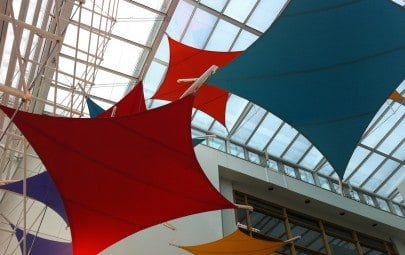 Kite shaped fabric sun shades for office building