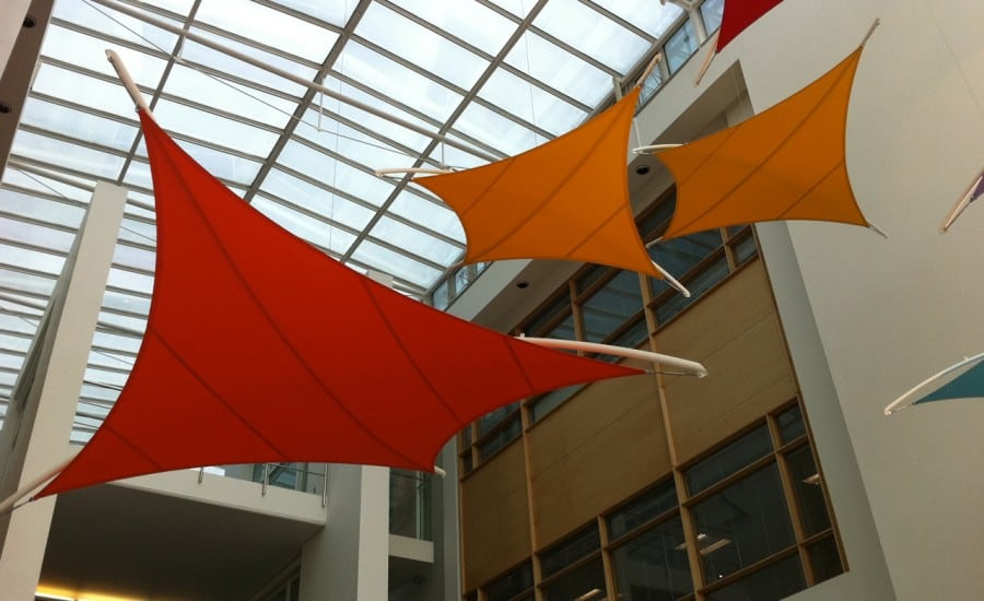 Coloured tensile fabric shades in office