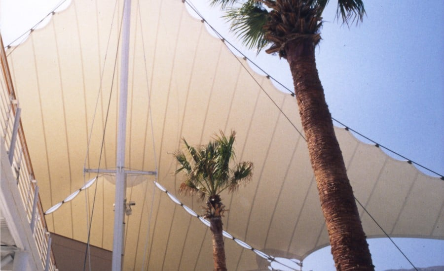 Tensioned fabric shopping centre roof