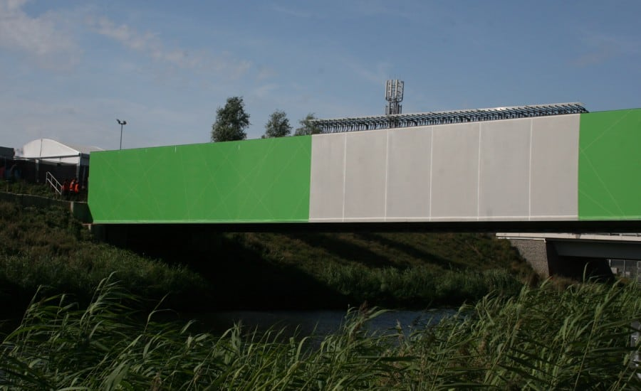 Bridge clad in coloured tensile fabric