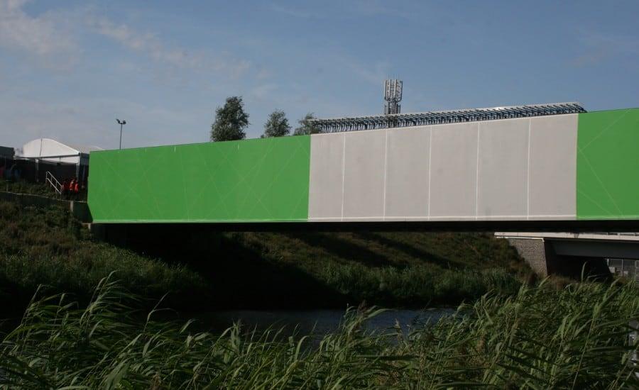 Bridge clad in coloured tensile fabric