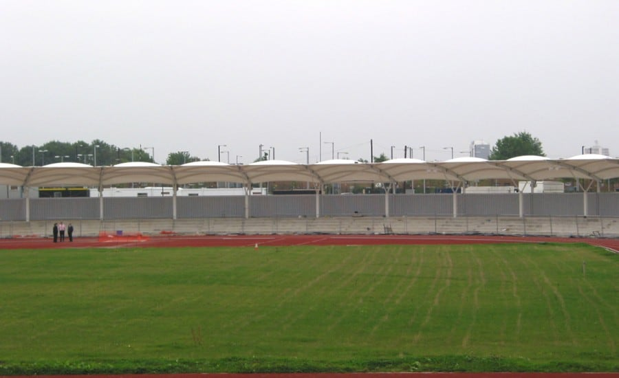 Fabric canopies surrounding sports stadium
