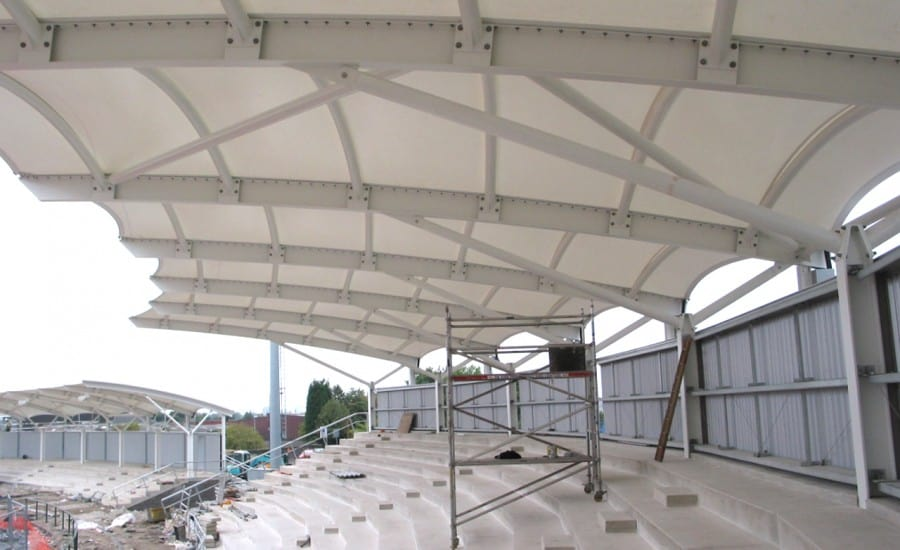 Canopies proving weather protection for athletics stadium