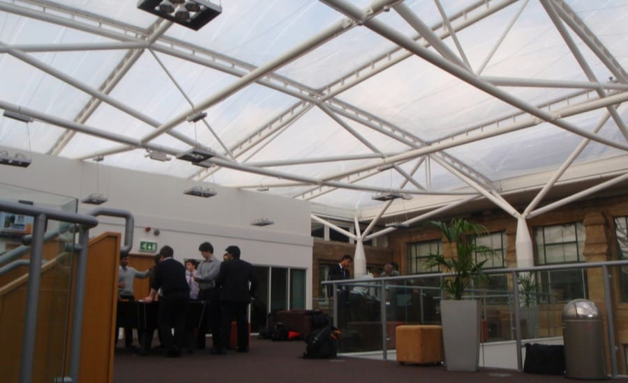 Light transmitting fabric roof over school buildings