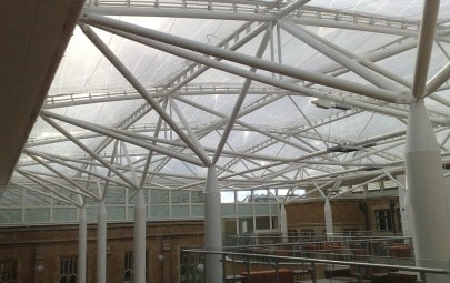 Tensile fabric roof covering school atrium