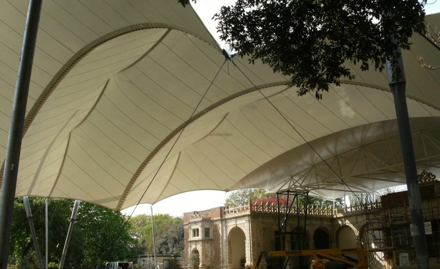 Tensile fabric canopy over Grade 1 listed building