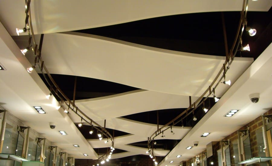 Suspended wave ceiling panels
