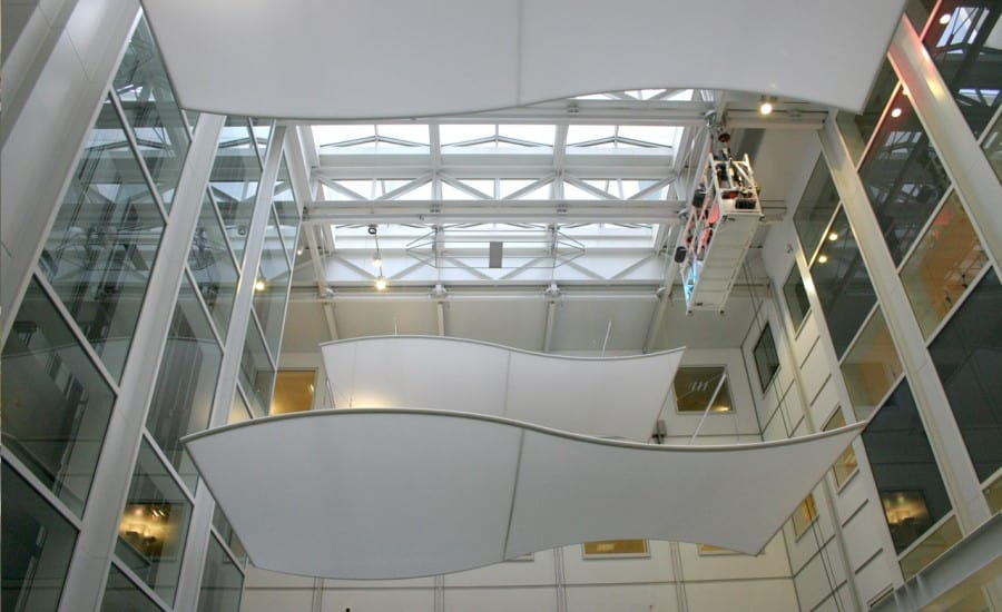 Suspended curved ceiling panels