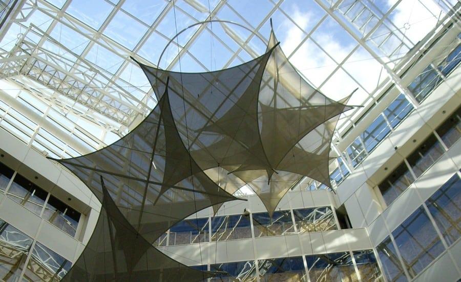 Shade providing tensile fabric shapes