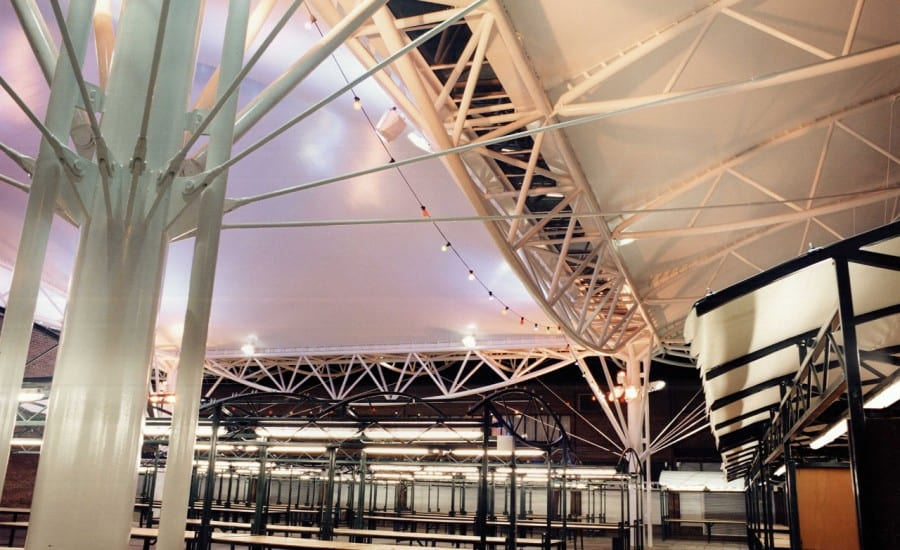Mast supported tensile fabric canopies