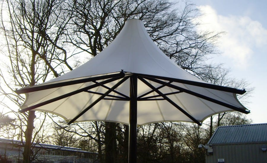 Tensile fabric umbrella for school courtyard