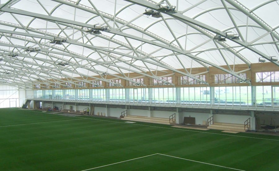 Tensile fabric roof covering football pitch
