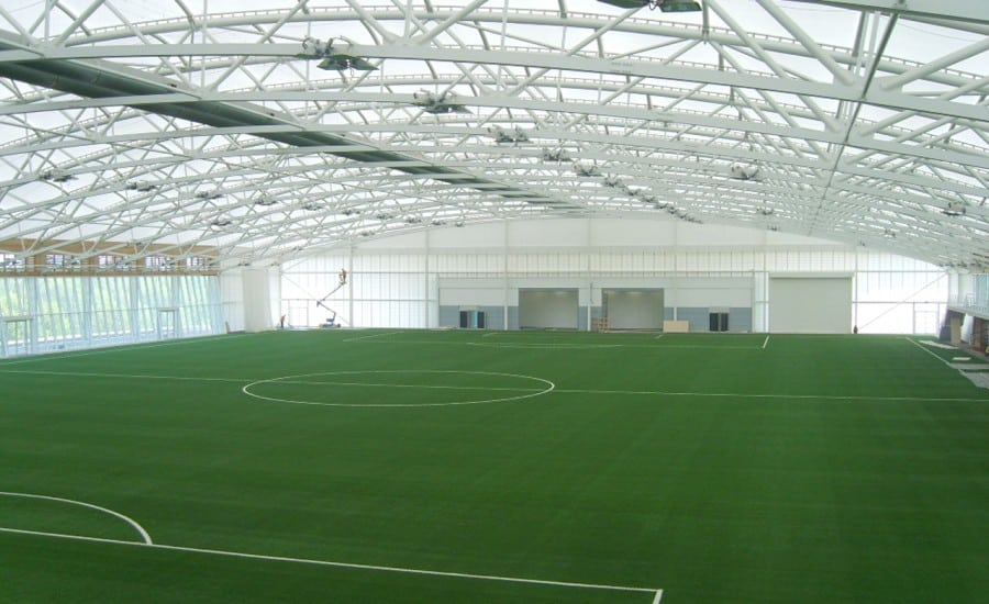 Football pitch covered by large tensile roof