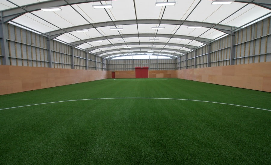Tensile fabric roof structure over training ground