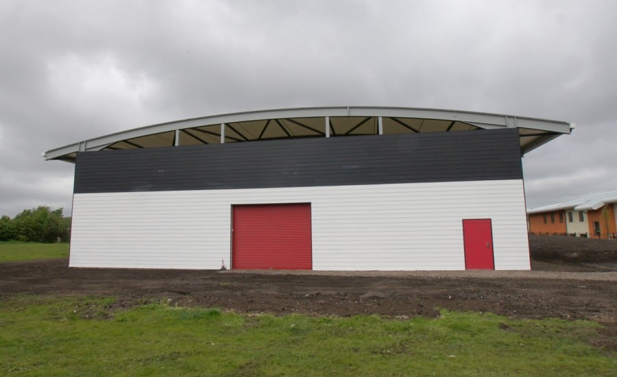 Fabric roof over sports facility