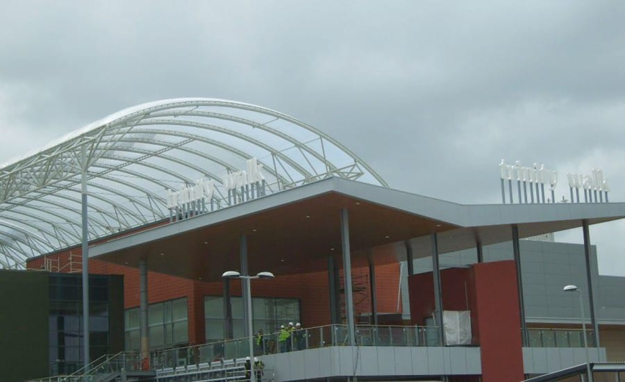 Clear tensile fabric roof covering shopping centre