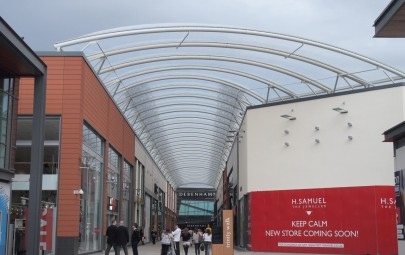 Curved tensile fabric roof