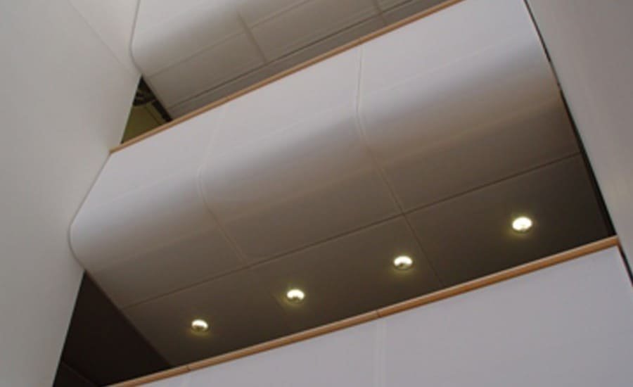 Tensile fabric cladding covering walkway