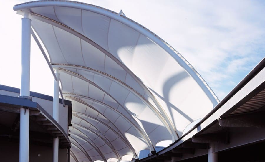 Tubular steel arches clad with PTFE