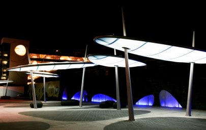 Fabric canopy structures with integrated lighting