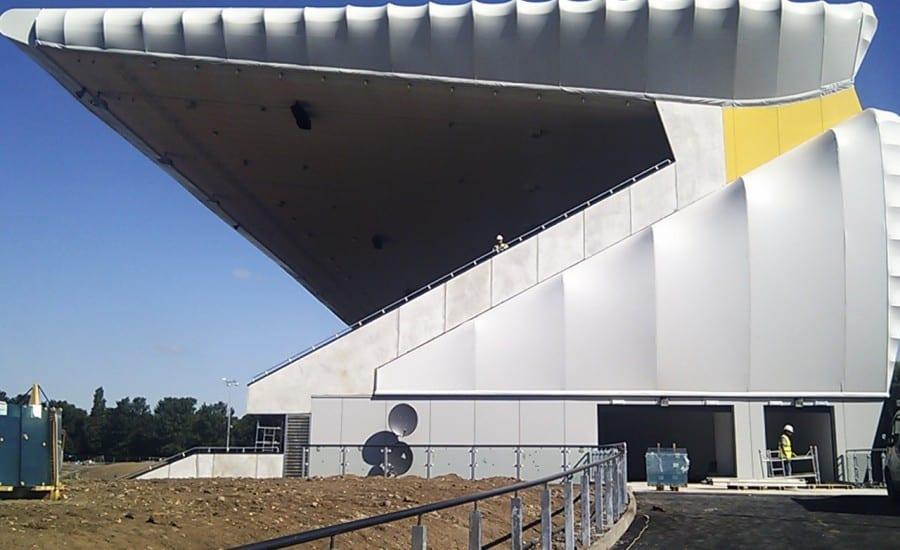 Tensile fabric cladding for athletics stadium