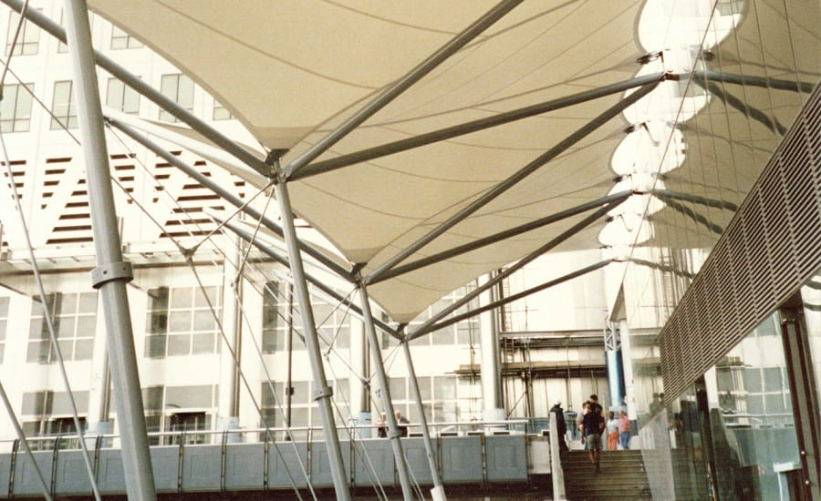 Wind deflecting fabric canopy