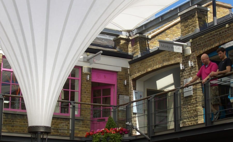 Removable courtyard canopies