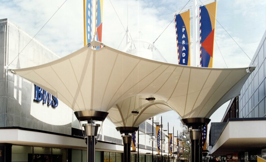 Inverted fabric cones providing weather cover in shopping centre