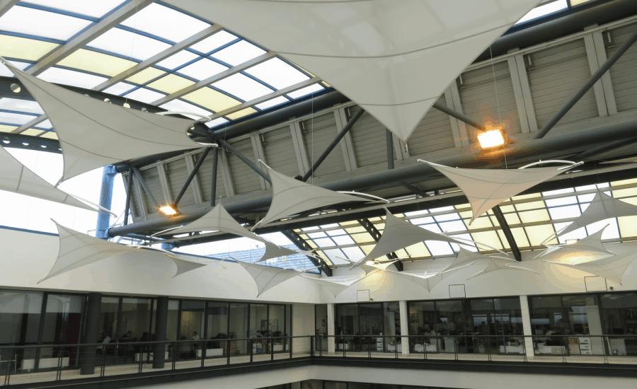 Suspended fabric kites