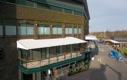Tensile fabric terrace awnings