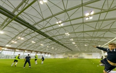 Tensile fabric roof over a football pitch
