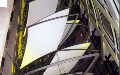 Internal floating fabric panels in atrium