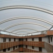 Single layer ETFE foil in barrel vault canopy